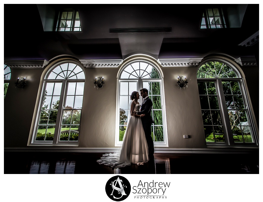 Bride and groom stand inside Atherton House Goulburn during formal wedding photos